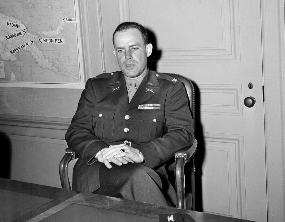 FILE - In this April 22, 1944 file photo, Col. William Darby, infantry commanding officer of the Range Force which took part in the North African and Italian campaigns of World War II, and the raid on Dieppe, talks to reporters at a news conference in the Pentagon in Washington. Current and former American soldiers will carry on their respect and admiration for Darby this week with a 40-mile march that will end in the northern Italian village where he was killed by enemy fire on April 30, 1945. (AP Photo/John Rous, File)