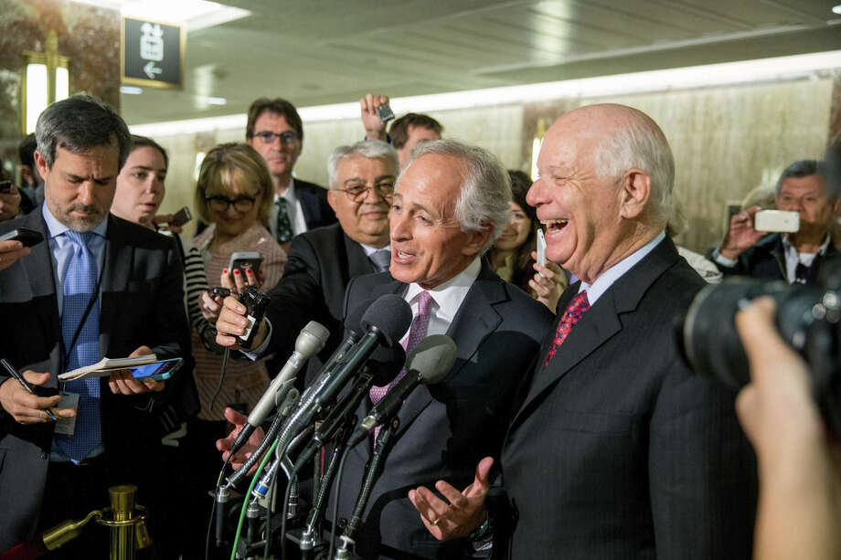 """FILE - In this April 14, 2015 file photo, Senate Foreign Relations Committee Chairman Sen. Bob Corker, R-Tenn., center, and the committee's ranking member Sen. Ben Cardin, D-Md., right, speak to reporters on Capitol Hill in Washington. Senate proponents of a bill empowering Congress to review and potentially reject any Iran nuclear deal must first win a battle with some colleagues determined to change the legislation in ways that could sink it. """"Anybody who monkeys with this bill is going to run into a buzz saw,"""" Republican Sen. Lindsey Graham of South Carolina warned ahead of this week's debate. Also trying to discourage any changes, Democratic Sen. Bob Menendez of New Jersey urged senators to stick with the plan as it emerged from the Senate Foreign Relations Committee. (AP Photo/Andrew Harnik, File)"""