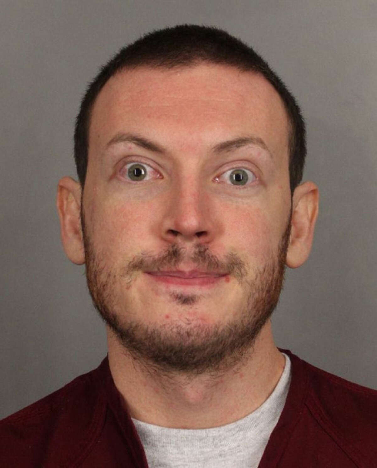 FILE - This file photo released on Sept. 20, 2012 by the Arapahoe County Sheriff's Office shows Colorado movie theater shooter James Holmes. While on the stand on July 28 and 29, 2015, Robert Holmes testified that his son came home from winter break from graduate school in 2011, several months before the shooting, and was making odd facial expressions which his parents had not seen in him before. (AP Photo/Arapahoe County Sheriff via AP)