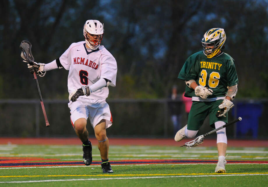 Lacrosse action between the Brien McMahon Senators and the Trinity Catholic Crusaders at Brien McMahon High School on April 26, 2016 in Norwalk, Connecticut.