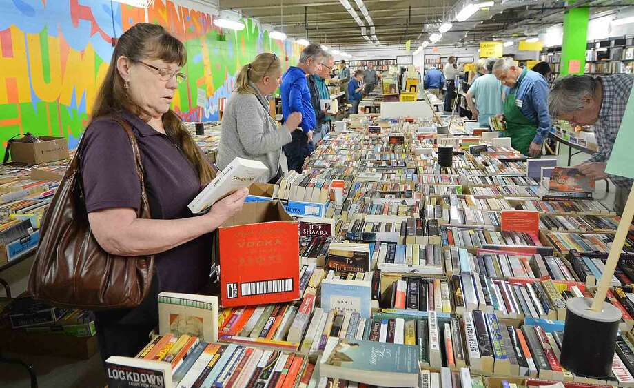 Erika Chamberlain has a box half full while looking for novels and poetry during the Wilton Library Annual Gigantic Book Sale on Sunday in Wilton Conn. April 24 2016