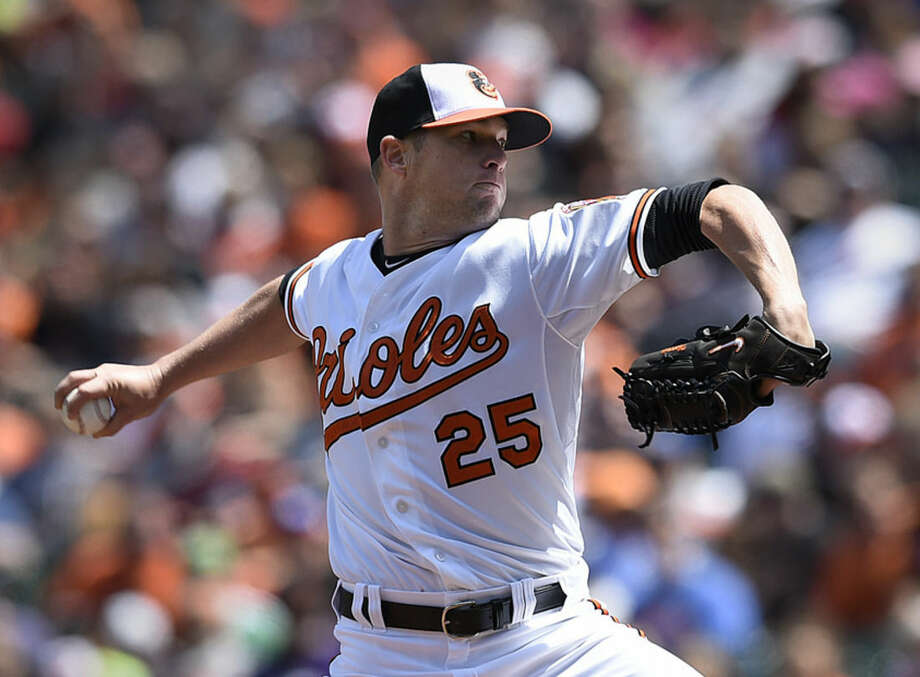 Baltimore Orioles starting pitcher Bud Norris throws against the Boston Red Sox in the first inning of a baseball game, Sunday, April 26, 2015, in Baltimore. (AP Photo/Gail Burton)