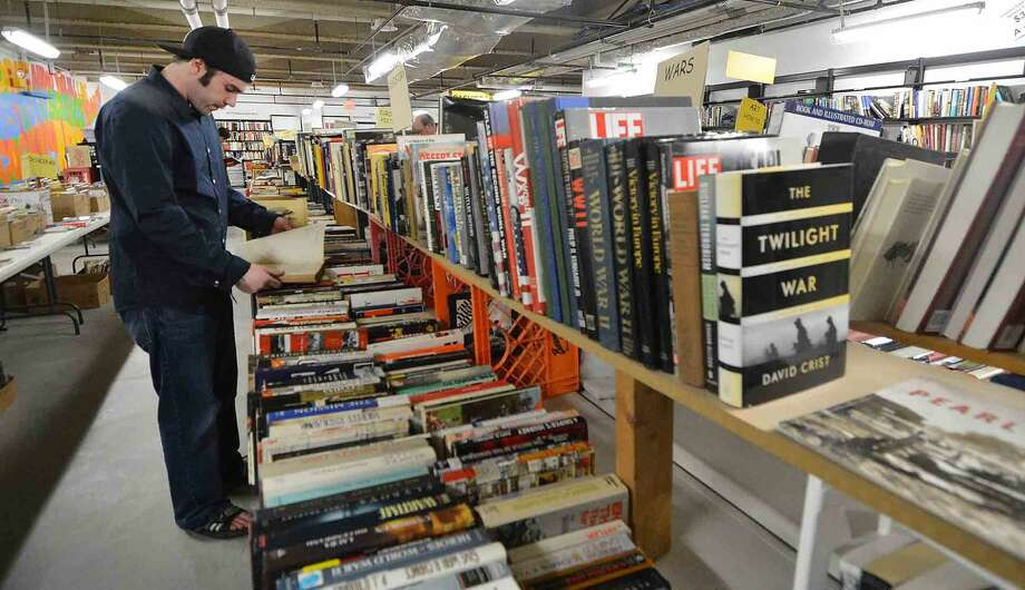 Anthony Centrilla checks out some books on U.S. history during the Wilton Library Annual Gigantic Book Sale on Sunday in Wilton Conn. April 24 2016
