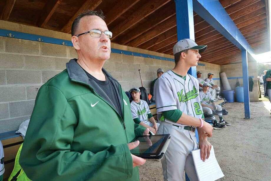Steve Brueski uses a tablet as he keeps track of the Norwalk high School baseball team during a game on Thursday April 21 2016
