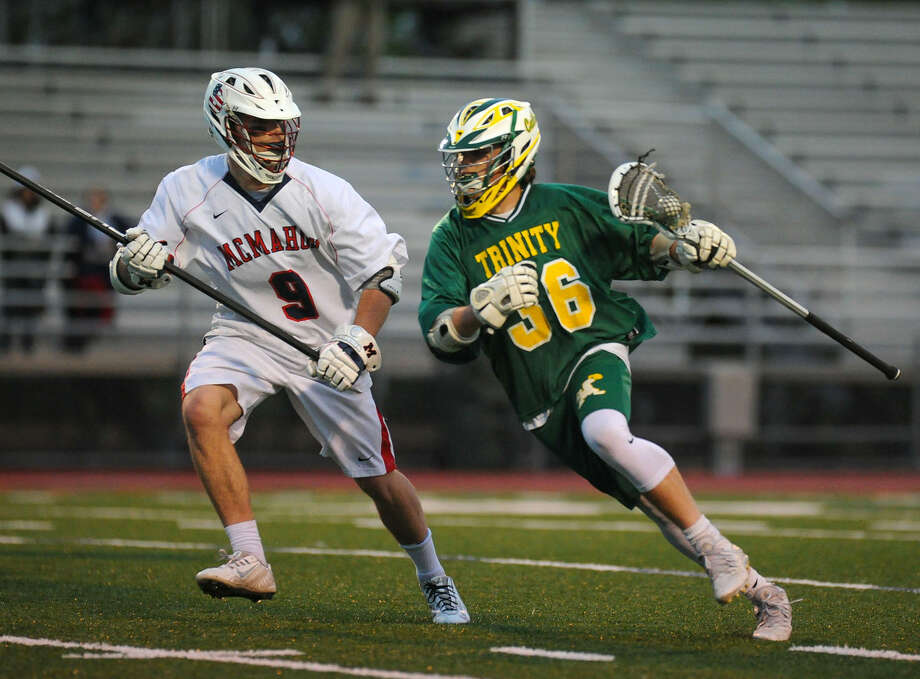 Mahon's Will Haskell on defense as Liam Shanahan (36) of the Trinity Catholic Crusaders looks to score during a game against the Brien McMahon Senators at Brian McMahon High School on April 26, 2016 in Norwalk, Connecticut.