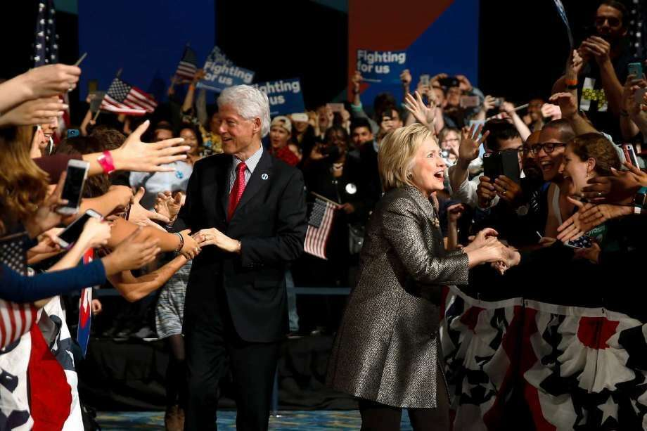 Democratic presidential candidate Hillary Clinton and Former President Bill Clinton move to the stage at her presidential primary election night rally, Tuesday, April 26, 2016, in Philadelphia. (Photo: Matt Rourke, AP)