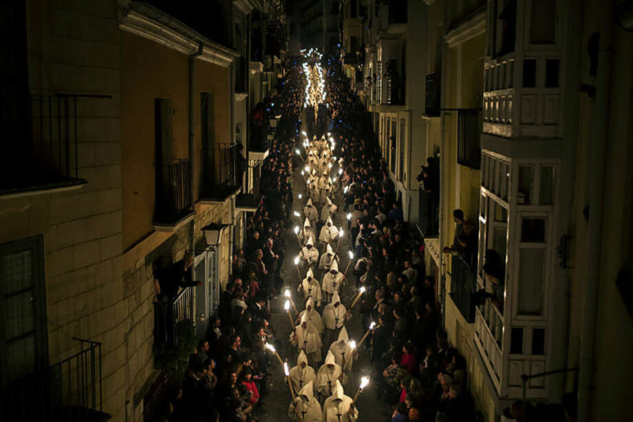 Penitents from 'Cristo de la Buena Muerte' or 'Good Dead Christ' brotherhood take part in a procession in Zamora, Spain, on the early hours of Tuesday, April 15, 2014. Hundreds of processions take place throughout Spain during the Easter Holy Week. (AP Photo/Andres Kudacki)