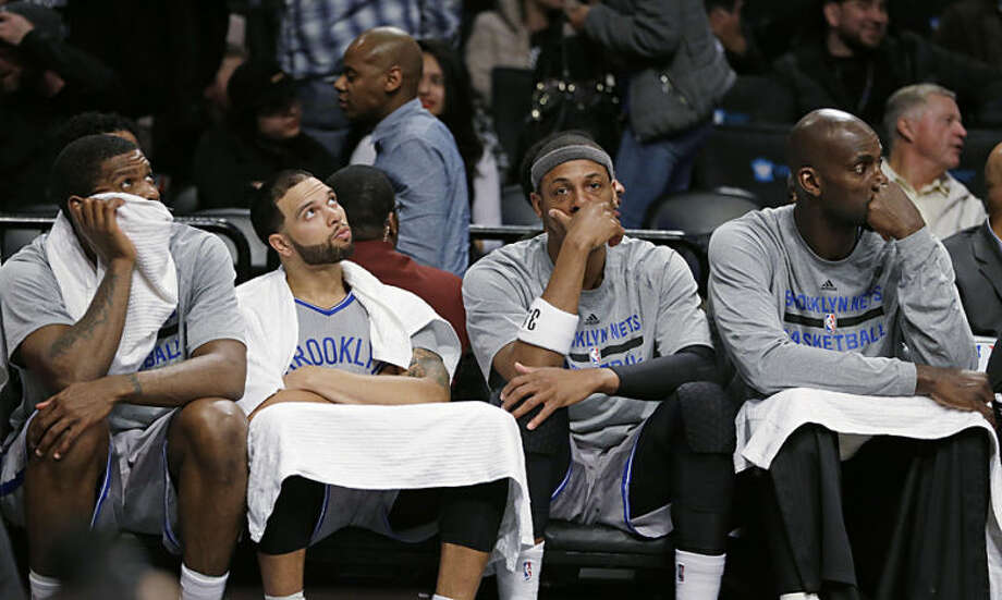 Brooklyn Nets' Joe Johnson, Deron Williams, Paul Pierce and Kevin Garnett, from left, watch during the second half of an NBA basketball game against the New York Knicks Tuesday, April 15, 2014, in New York. The Knicks won 109-98. (AP Photo/Frank Franklin II)