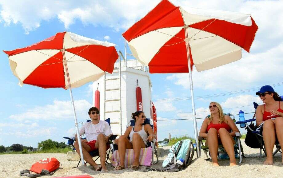Lifeguards try to stay cool under beach umbrellas while on duty at Gulf Beach in Milford, Conn. on Tuesday July 16, 2013. (Photo: Christian Abraham)