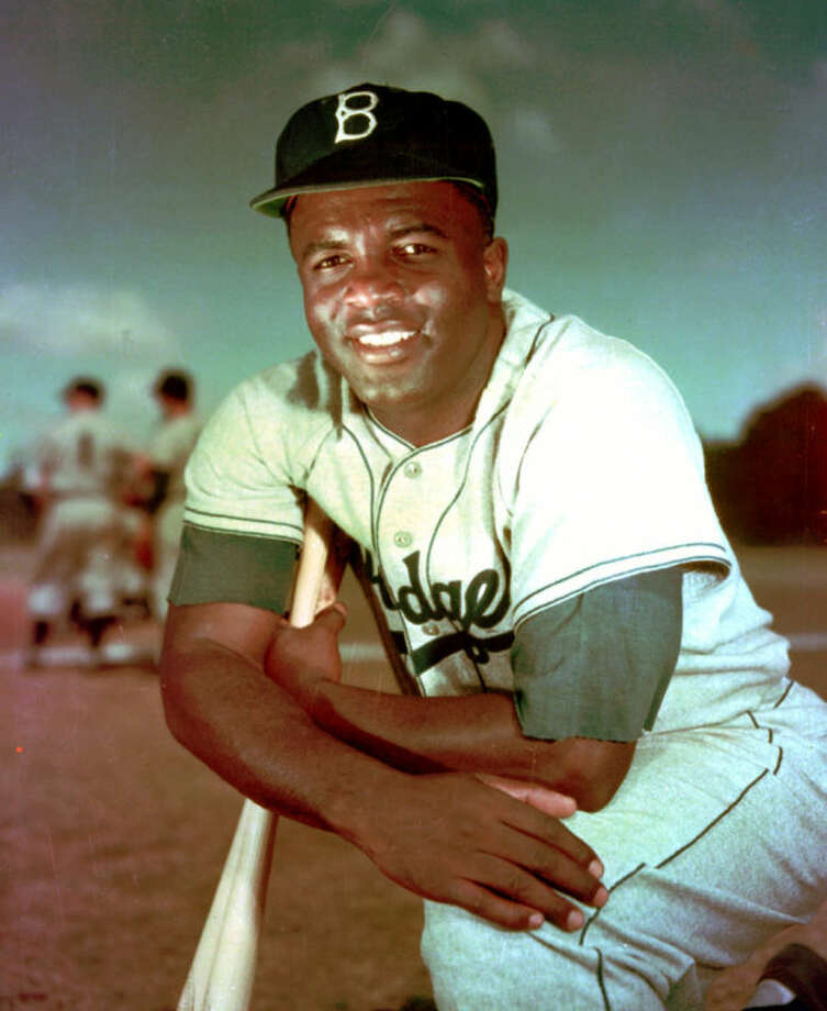 FILE - In this 1952 file photo, Brooklyn Dodgers baseball player Jackie Robinson poses. Baseball holds tributes across the country on Jackie Robinson Day, Tuesday, April 15, 2014, the 67th anniversary marking the end of the game's racial barrier. (AP Photo/File)