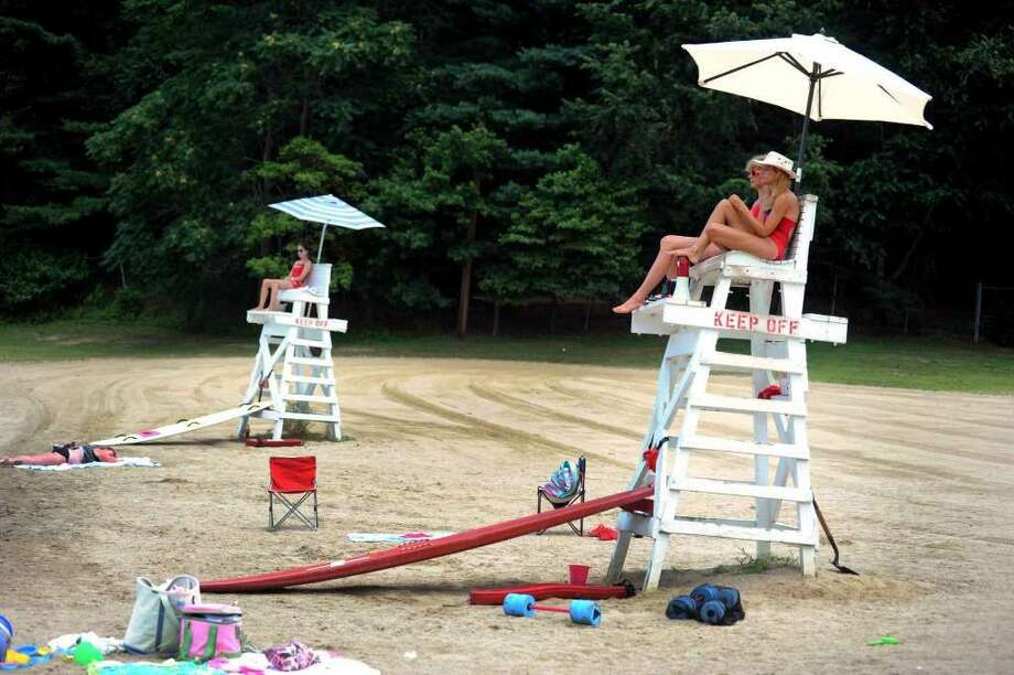 Lifeguards watch over the beach area at Lake Mohegan in Fairfield, Conn. on Wednesday July 18, 2012. (Photo: Autumn Driscoll)