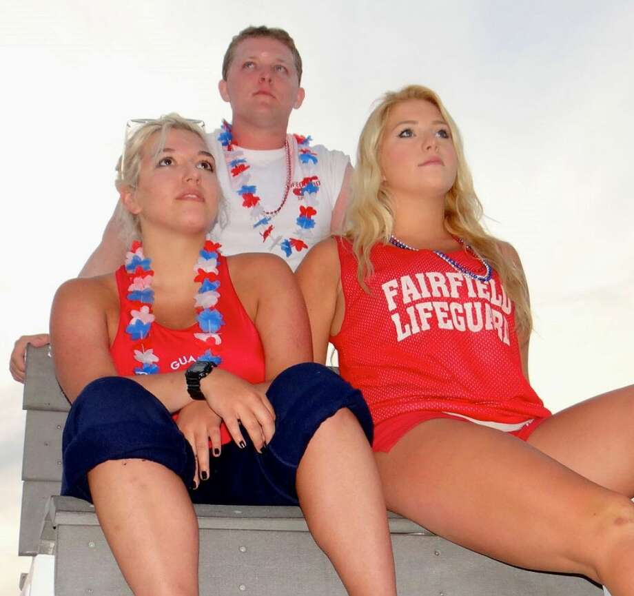 Lifeguards Harley French, her sister Rebecca and Eric Rasmussen keep watch over the crowds at the fireworks show in Fairfield. (Photo: Mike Lauterborn)