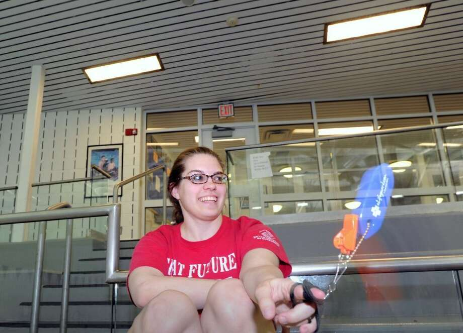 Laura Culver, a lifeguard, spins her whistle while keeping an eye on swimmers in the pool during the free swim at the Boys & Girls Club of Greenwich, Friday afternoon, May 9, 2014. (Photo: Bob Luckey)