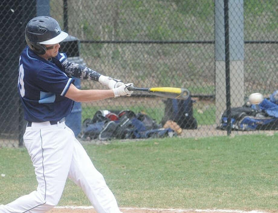 Wilton #19 Scott Shovlin a base hit to left field against Stamford High School. Hour photo/Matthew Vinci