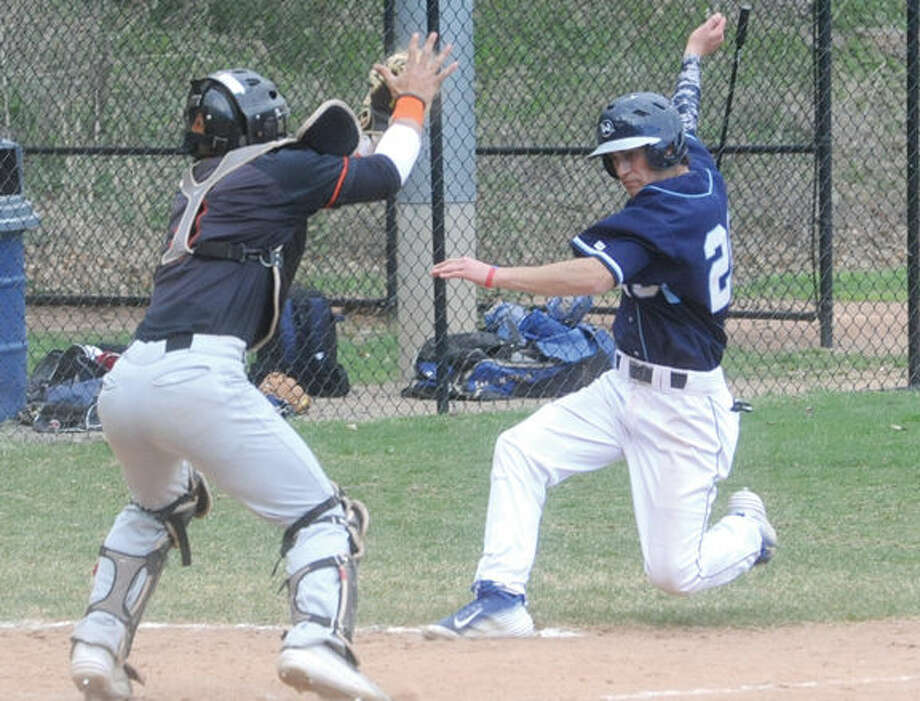 A collision at home Wilton's Paul Sorbo is out Stamford catcher Tyler Sericchio. Hour photo/Matthew Vinci