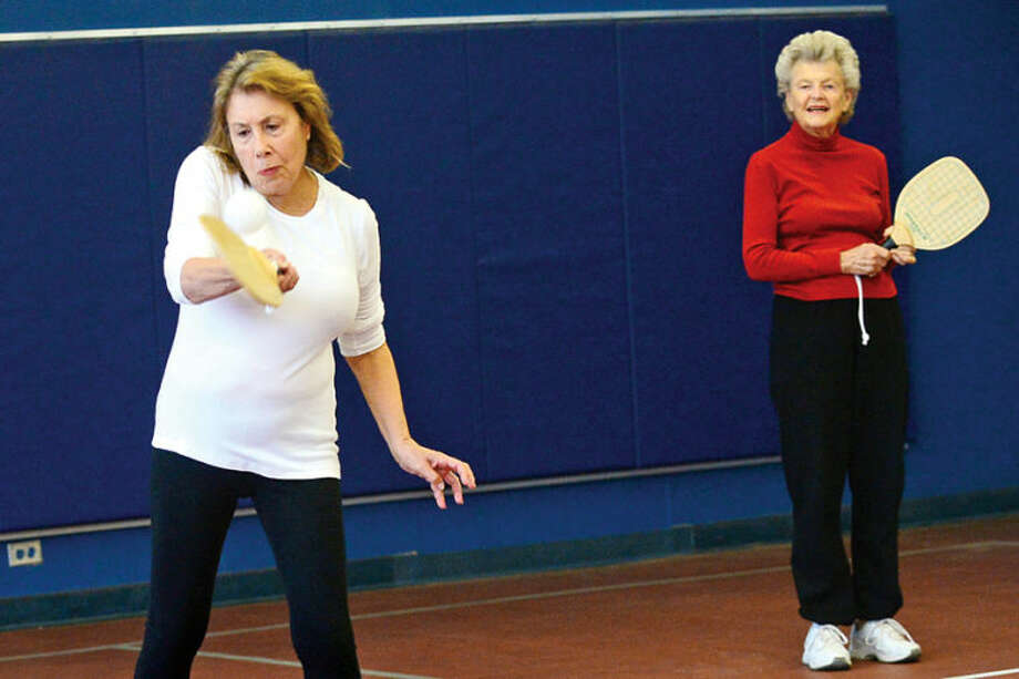 Wilton residents Florine Kruger and Sylvia Brown play in the inaugural game of pickleball at the Comstock Community Center Tuesday morning. The new sports club was organized by P&R Commissioner Anne Richards.