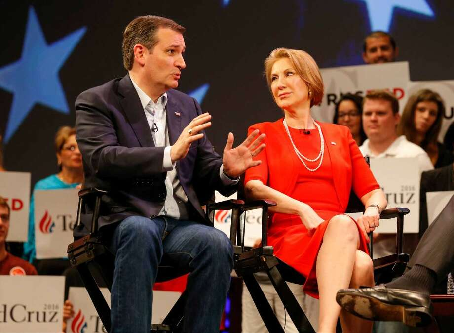 In this photo taken March 11, 2016, Republican presidential candidate, Sen. Ted Cruz, R-Texas speaks to Carly Fiorina in Orlando, Fla., Friday, March 11, 2016. According to an AP Source: Cruz has picked Fiorina as his running mate (Photo: Mike Carlson)