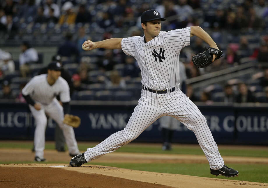 New York Yankees pitcher Adam Warren delivers against the Tampa Bay Rays in the first inning of a baseball game, Monday, April 27, 2015, in New York. (AP Photo/Julie Jacobson)