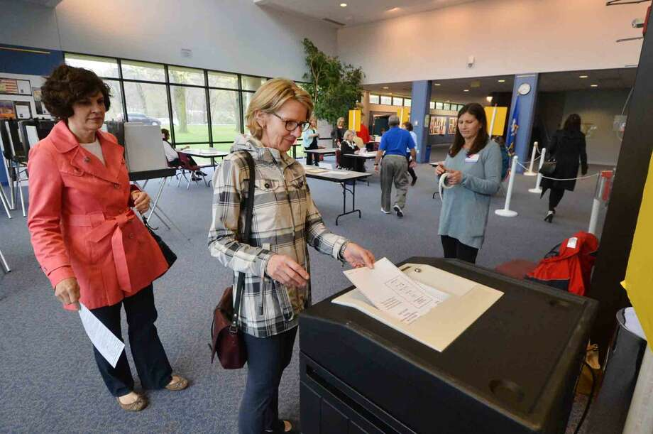 Joan Norfleet casts her vote at Wilton High School District 1 during Presidential Primary voting in Wilton Conn. on Tuesday April 26