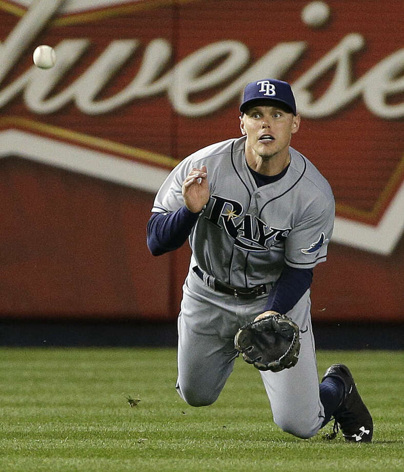 Tampa Bay Rays left fielder Brandon Guyer (5) dives unsuccessfully for a ball hit by New York Yankees' Brett Gardner in the seventh inning of a baseball game, Monday, April 27, 2015, in New York. Gardner was credited with a double on the play. (AP Photo/Julie Jacobson)