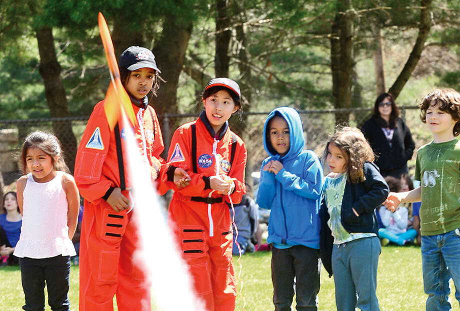 Hour photo / Erik Trautmann Young Astronauts Makayla Whittingham and Jackie Cross launch a model rocket during the kick off event for Columbus Science Magnet School's Young Astronauts 2015 mission, Infinite Vision, Friday afternoon.