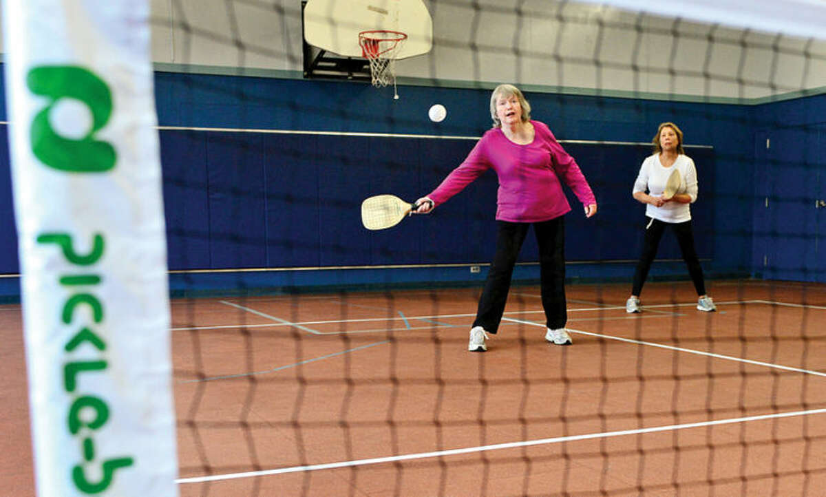 P&R Commissioner Anne Richards and Florine Kruger play the inaugural game of pickleball at the Comstock Community Center Tuesday morning.