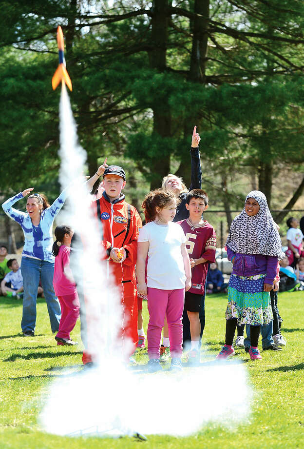Hour photo / Erik Trautmann Young Astronaut JR Kennedy launches a model rocket during the kick off event for Columbus Science Magnet School's Young Astronauts 2015 mission, Infinite Vision, Friday afternoon.