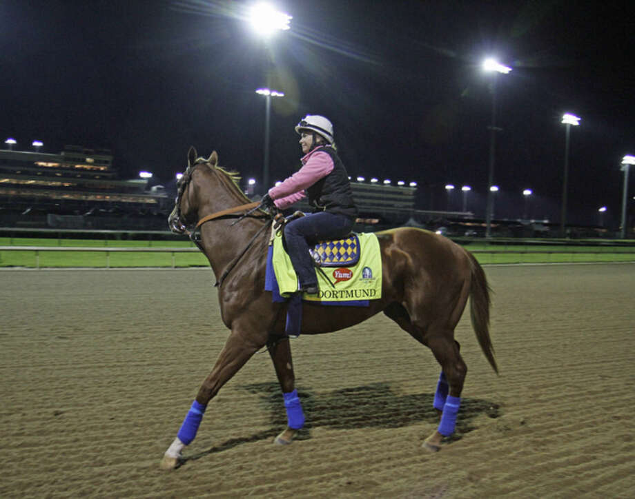 Kentucky Derby entrant Dortmund, with exercise rider Dana Barnes aboard, goes to the track for his morning gallop at Churchill Downs in Louisville, Ky., Friday, May 1, 2015. (AP Photo/Garry Jones)