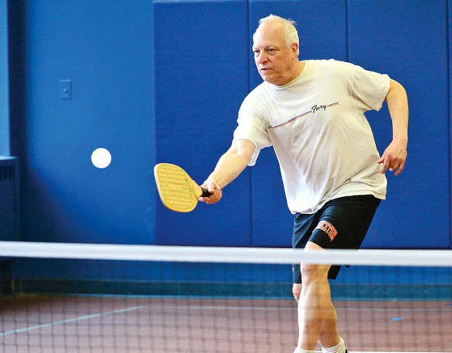 Wilton resident John Raggazini plays in the inaugural game of pickleball at the Comstock Community Center Tuesday morning. The new sports club was organized by P&R Commissioner Anne Richards.
