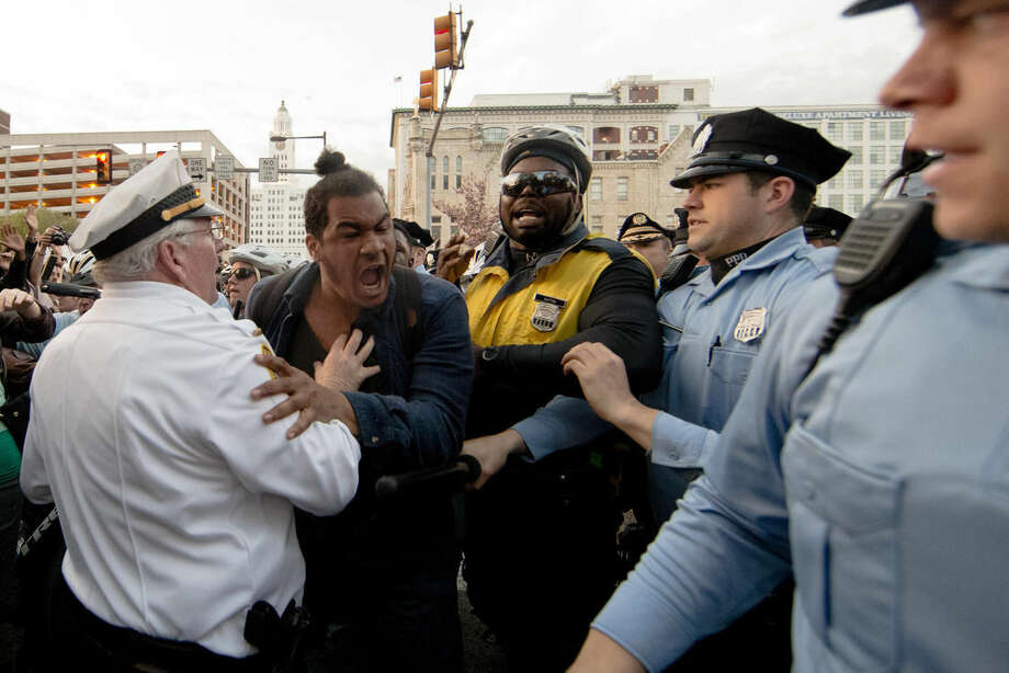 Protesters clash with police in Philadelphia on Thursday, April 30, 2015. The event in Philadelphia follows days of unrest in Baltimore amid Freddie Gray's police-custody death. (AP Photo/Matt Rourke)