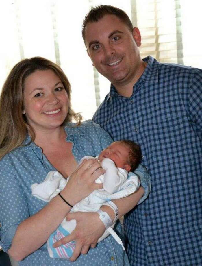 Proud parents Kate and John Procaccini, with their newborn daughter, Mila Joy, at Norwalk Hospital a day after Westport emergency services personnel helped to deliver the baby at home when the mother went into early labor. (Photo: Westport Police)