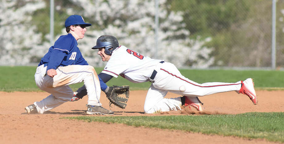 Brien McMahon base runner Mike Galyas, right, is caught trying to steal second as Fairfield Ludlowe second baseman Nate Klein waits for the ball to make the tag during the fourth inning of Frdiay's FCIAC baseball game in Norwalk. (Hour photo/John Nash)