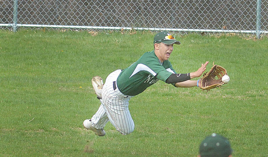 Norwalk's Moe Ortiz makes a diving catch against Westhill. (Hour Photo/Alex von Kleydorff)