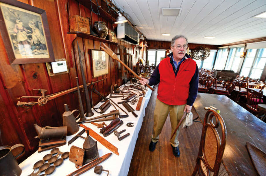 Hour photo / Erik Trautmann Silvermine Tavern owner Frank Whitman goes through all the unique antique items the tavern has collected over the years before they hold an estate sale April 25th.