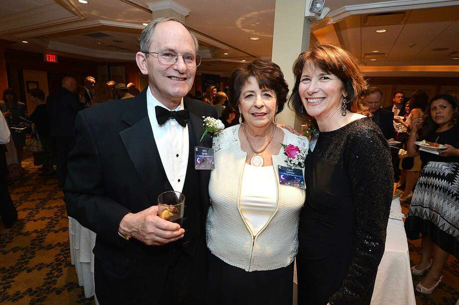 Hour Photo/Alex von Kleydorff Chairman of the Board Jerry Sprole, with Carol Salvato and Executive Director Valerie Williams help to raise money for Keystone House at the Mystery Gala