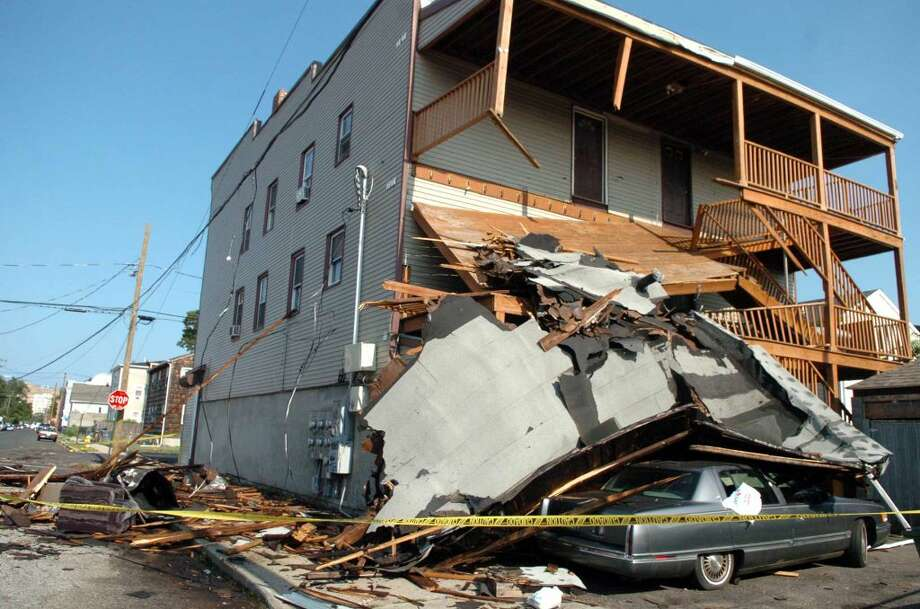 A collapsed porch on the corner of Jane and Kossuth Streets in Bridgeport Friday June 25, 2010. The damage was the result of a tornado with 100 mph winds that touched down in Bridgeport Thursday.