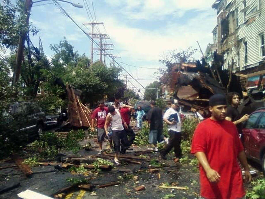 June 24, 2010: Residents check out the damage along East Main Street in Bridgeport after tornado came through the area on Thursday, June 24, 2010.