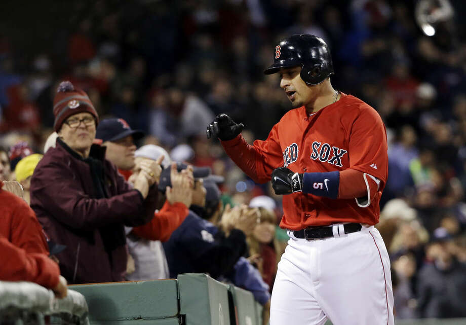 Boston Red Sox's Allen Craig claps his hands coming back to the dugout after hitting a solo homer in the fourth inning of a baseball game against the New York Yankees at Fenway Park in Boston, Friday, May 1, 2015. (AP Photo/Elise Amendola)