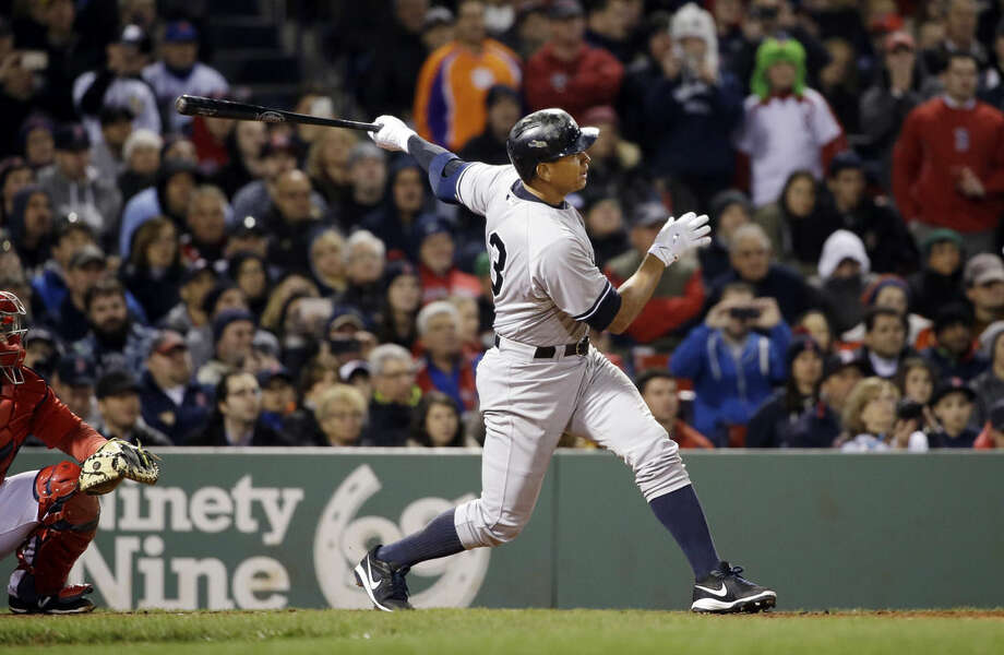 New York Yankees pinch hitter Alex Rodriguez hits a solo homer in the eighth inning of a baseball game against the Boston Red Sox at Fenway Park in Boston, Friday, May 1, 2015. Rodriguez has now tied slugger Willie Mays with 660 career home runs. (AP Photo/Elise Amendola)