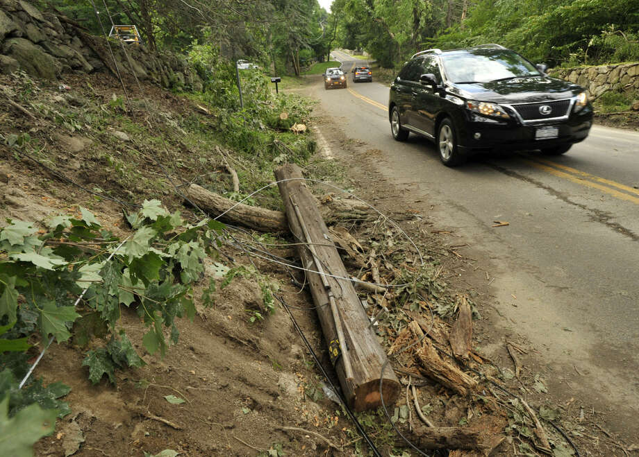 Storm debris lays on the side of Stanwich Road in Greenwich on Tuesday, July 2, 2013. On Tuesday, the National Weather Service said on Monday an EF0 tornado touched down creating a 3.7 mile-long path between Greenwich and Stamford.