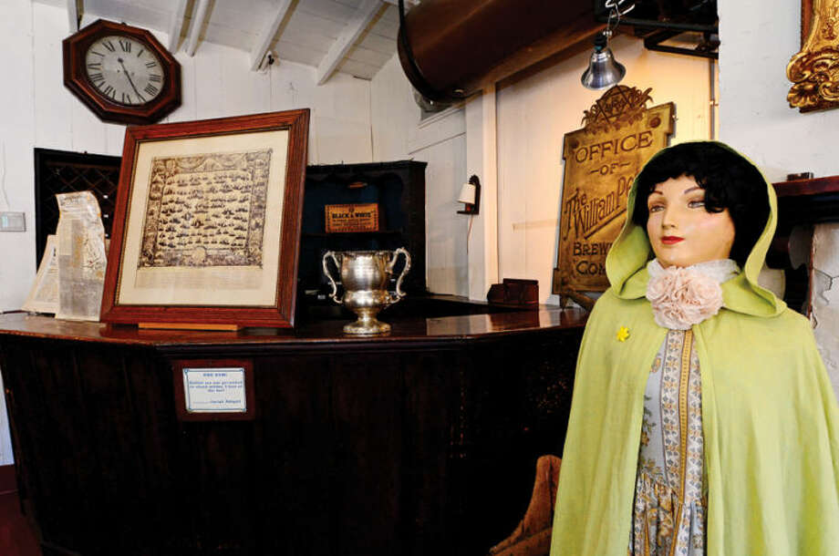 Hour photo / Erik Trautmann The mannequin Abigail was the first woman allowed at the Silvermine Tavern bar in the 19th century. New England Estate Sales will go through all the unique antique items the tavern has collected over the years before they hold an estate sale April 25th.