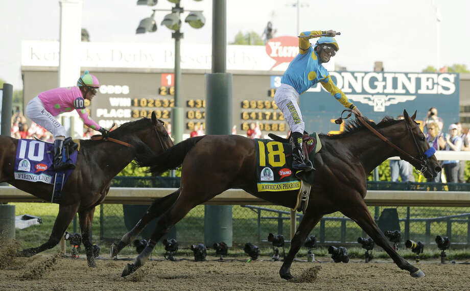 Victor Espinoza rides American Pharoah to victory in the 141st running of the Kentucky Derby horse race at Churchill Downs Saturday, May 2, 2015, in Louisville, Ky. (AP Photo/Morry Gash)