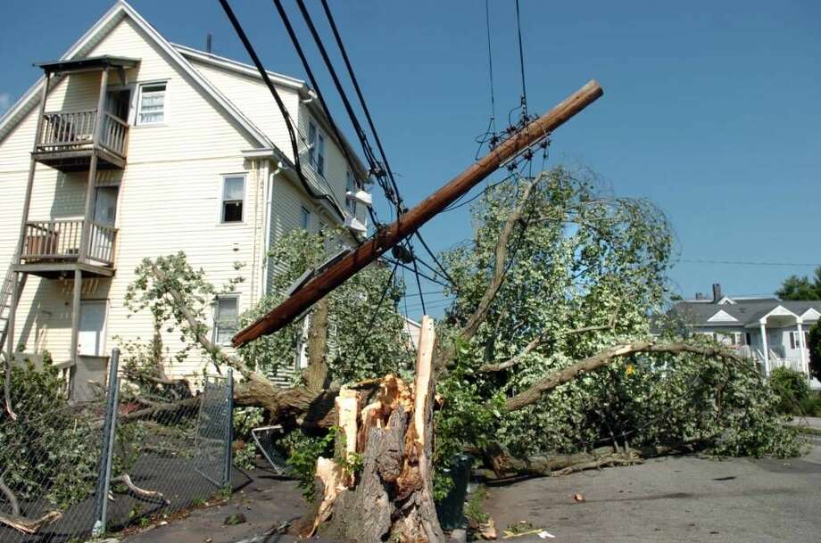 A split tree and power lines remain down on Stillman Street in Bridgeport Friday June 25, 2010. The damage was the result of a tornado with 100 mph winds that touched down in Bridgeport Thursday.