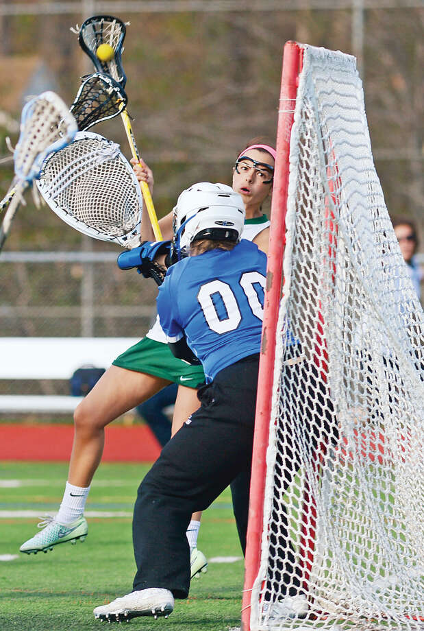Hour photo / Erik Trautmann Norwalk's Tess St. John takes a shot on Fairfield Ludlowe goalie Lindsey Ferrani in their game Saturday at Testa field.