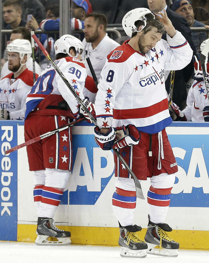 Washington Capitals left wing Alex Ovechkin (8) adjusts his helmet during a break in play against the New York Rangers during the first period of Game 2 in the second round of the NHL Stanley Cup hockey playoffs Saturday, May 2, 2015, in New York. (AP Photo/Frank Franklin II)