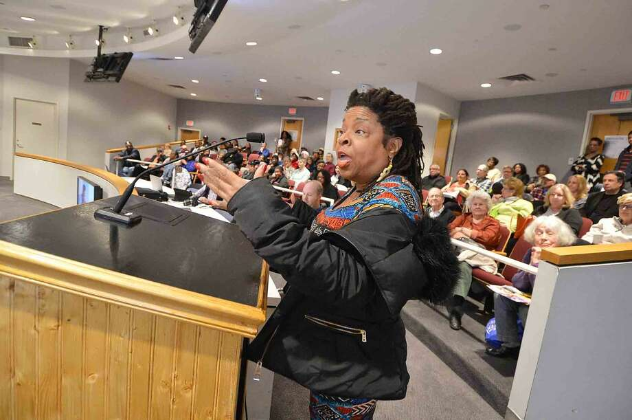 Angela Harrison voices her opinion to the Norwalk Human Relations Commission during a public hearing on a controversial City Hall mural that depicts slavery alongside a Mississippi riverboat. 'Steamboat days on the Mississippi' hangs in Norwalk City Hall in Norwalk.