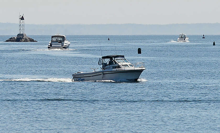 Hour photo / Erik Trautmann Boaters motor in the channel in Norwalk Harbor Saturday.