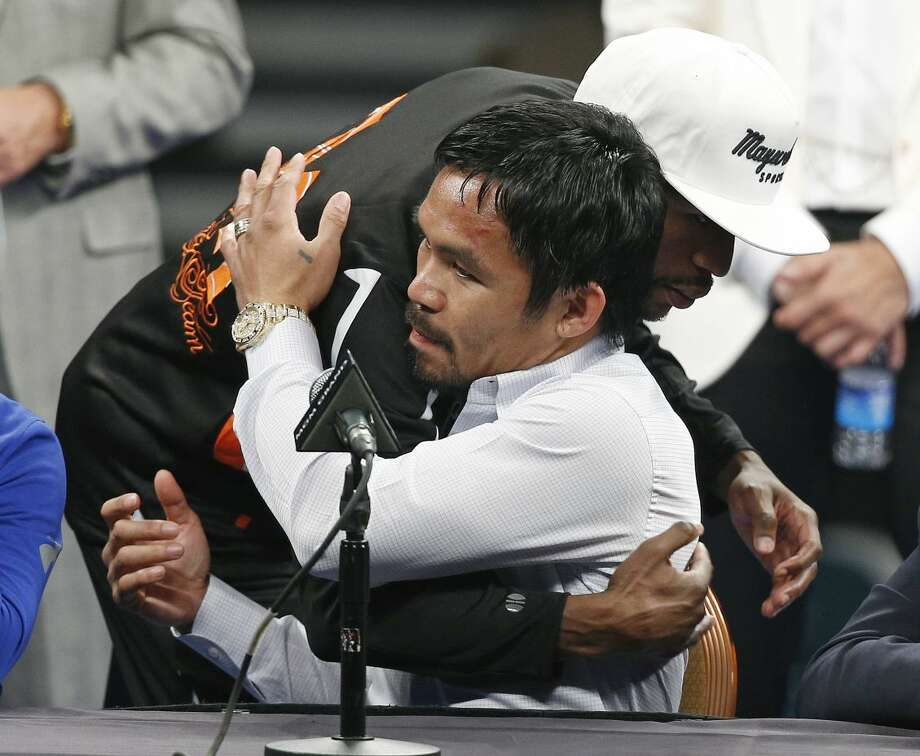 Manny Pacquiao is embraced by Floyd Mayweather Jr. during a press conference following their welterweight title fight on Saturday, May 2, 2015 in Las Vegas. Mayweather defeated Pacquiao in a unanimous decision. (AP Photo/John Locher)