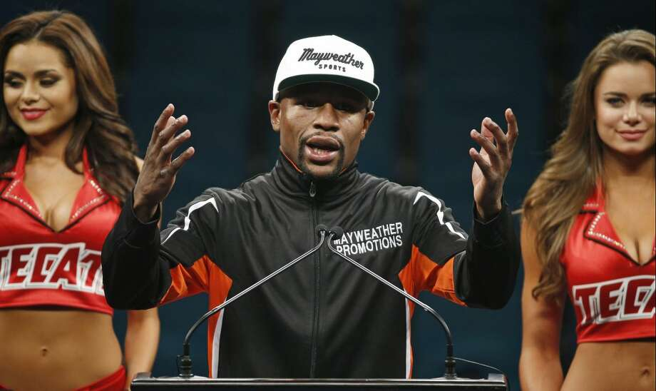 Floyd Mayweather Jr. gestures during a press conference following his welterweight title fight on Saturday, May 2, 2015 in Las Vegas. Mayweather defeated Manny Pacquiao in a unanimous decision. (AP Photo/John Locher)