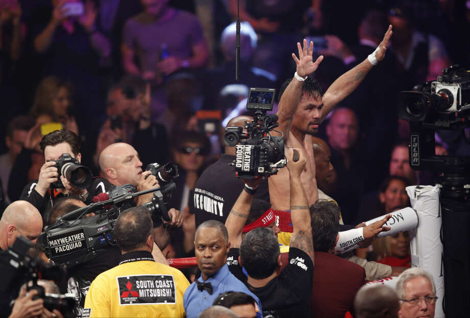 Manny Pacquiao, from the Philippines, waves to the crowd after his welterweight title fight fight against Floyd Mayweather Jr., on Saturday, May 2, 2015 in Las Vegas. (AP Photo/Eric Jamison)